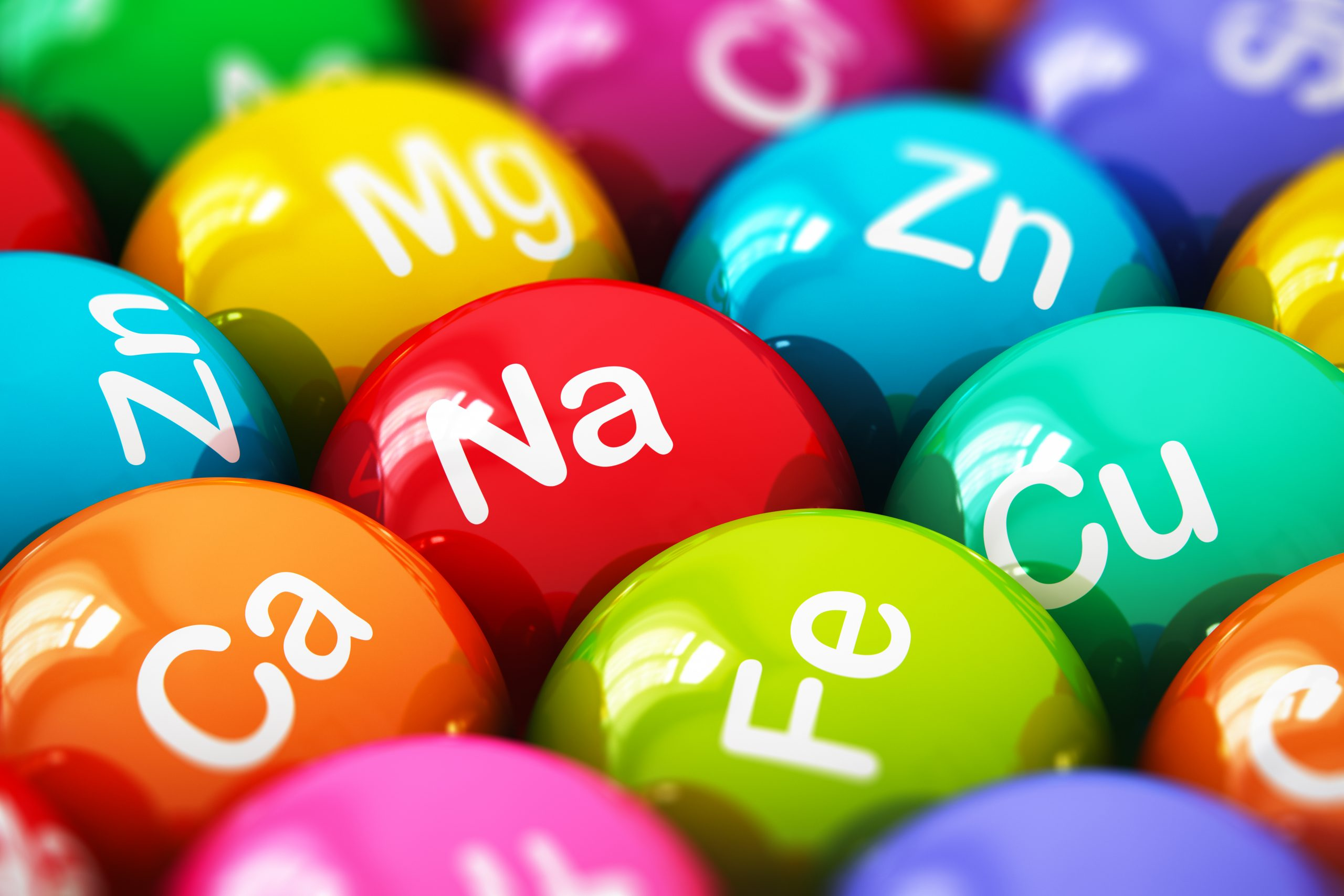 Macro view of colour balls with mineral elements written on them