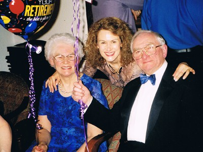 Norma and Derek with their daughter, Barbara Hudson at their retirement party