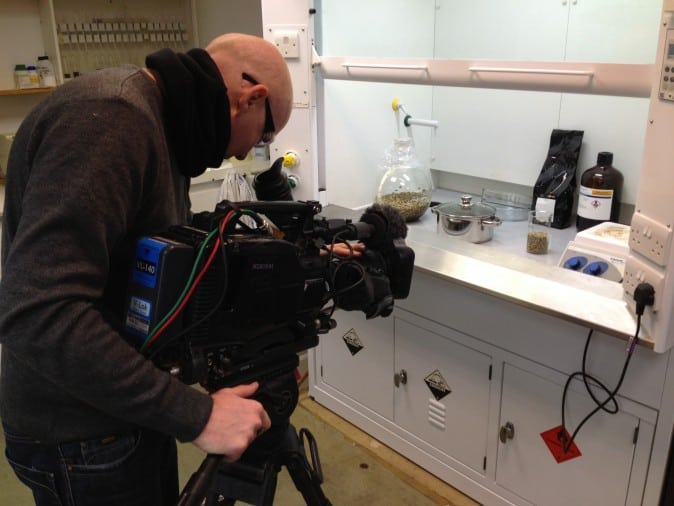 A cameraman at Channel 4 filming the production of decaffeinated coffee