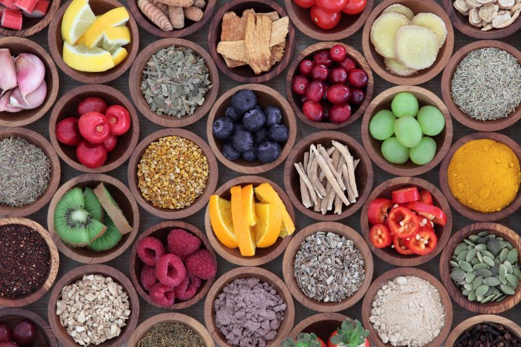 Top down view of various wooden bowls of fruit