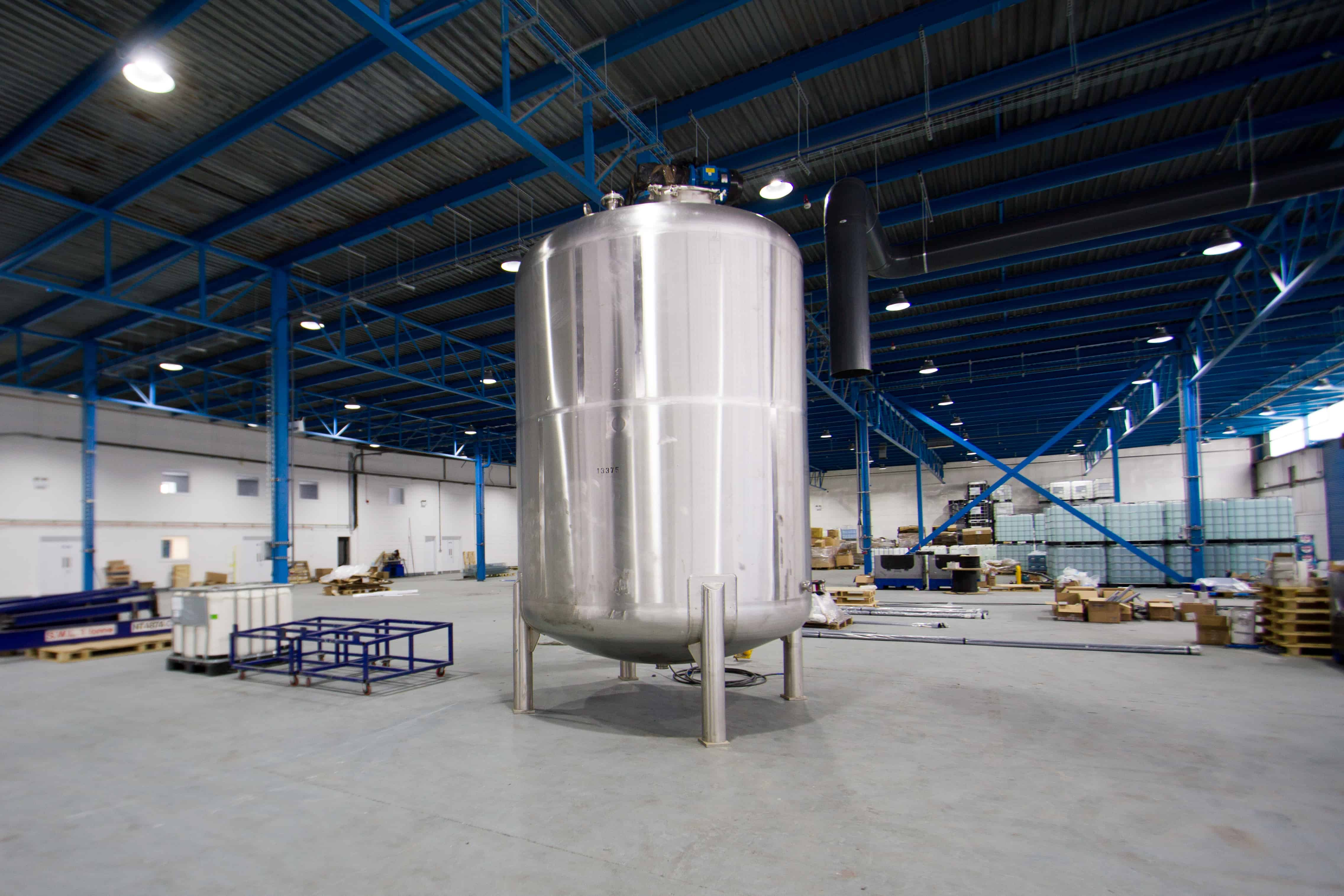 A large mixing vessel in the middle of a factory