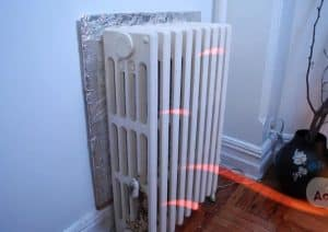 Tinfoil behind radiator life hacks to prevent heat loss