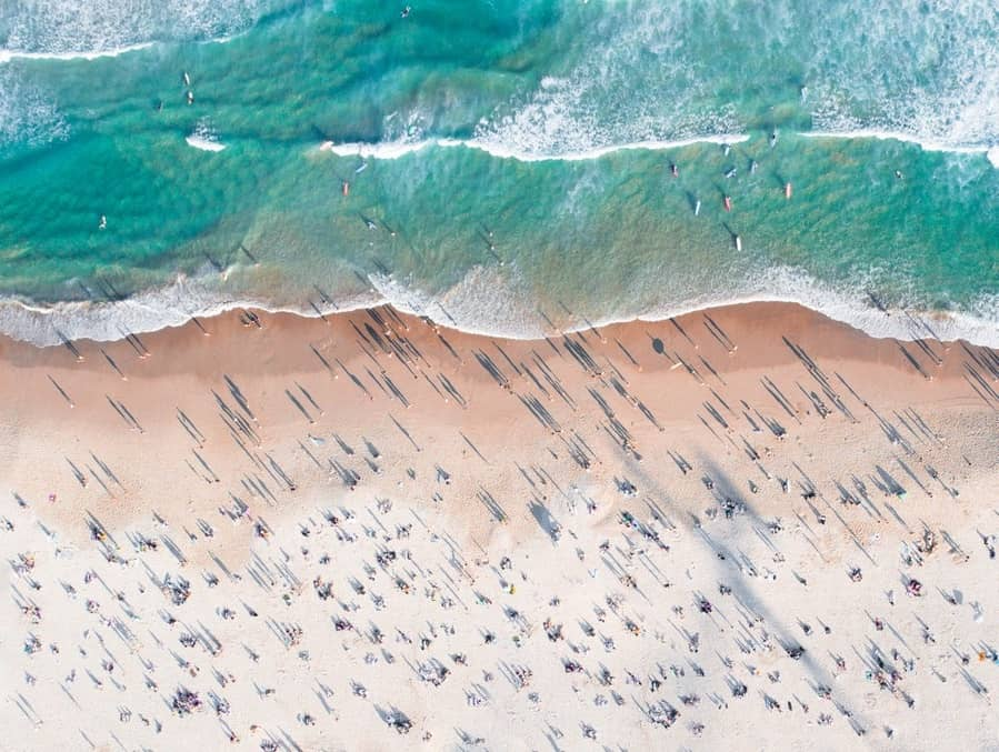 An aerial shot of people on a beach