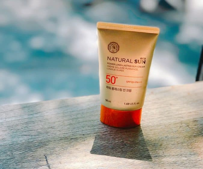 A bottle of sunscreen on a poolside